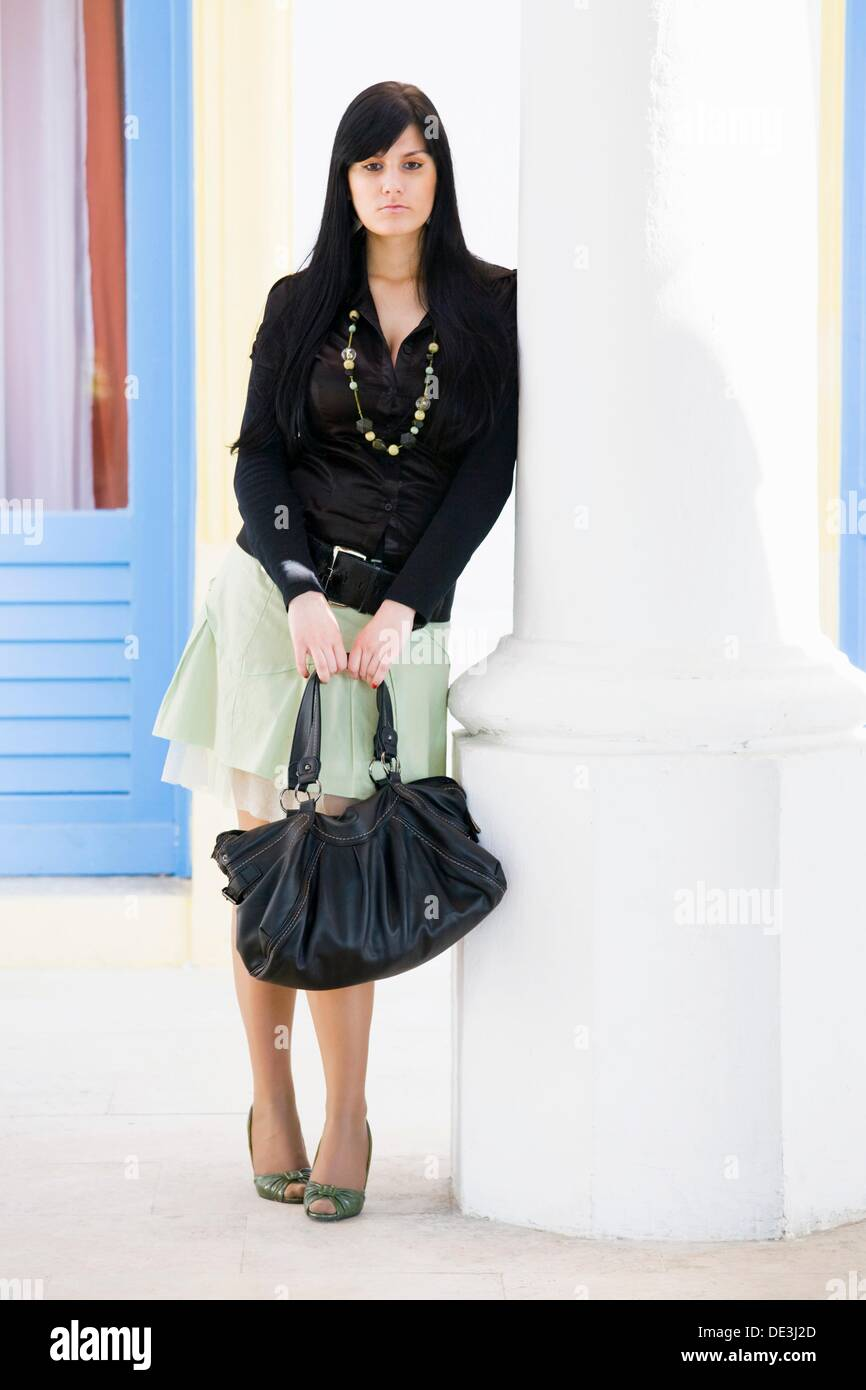 Young woman with a purse is sad Stock Photo