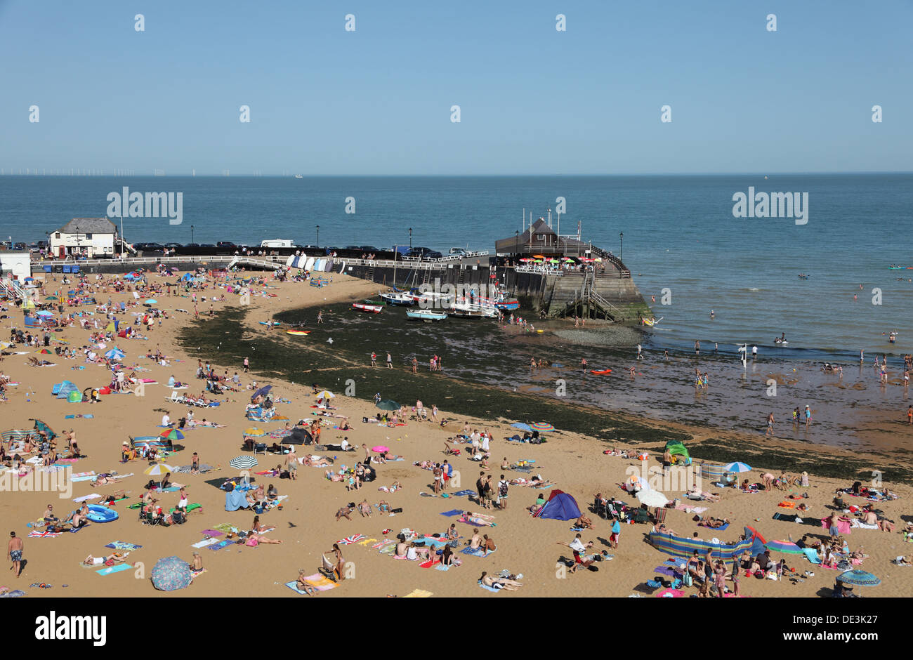 Sunbathers on the hottest day of the year on Broadstairs Viking Bay beach, Kent coast, England - Stock Image
