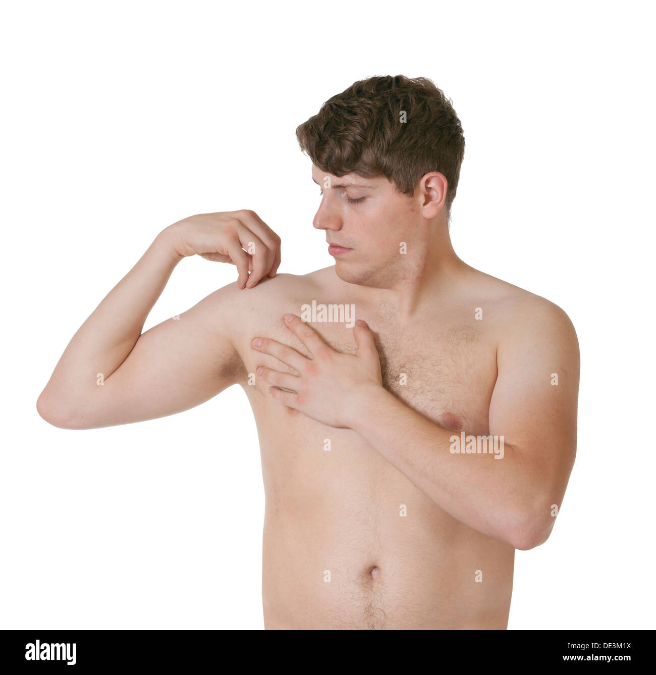 Man with shoulder pain on a white background - Stock Image