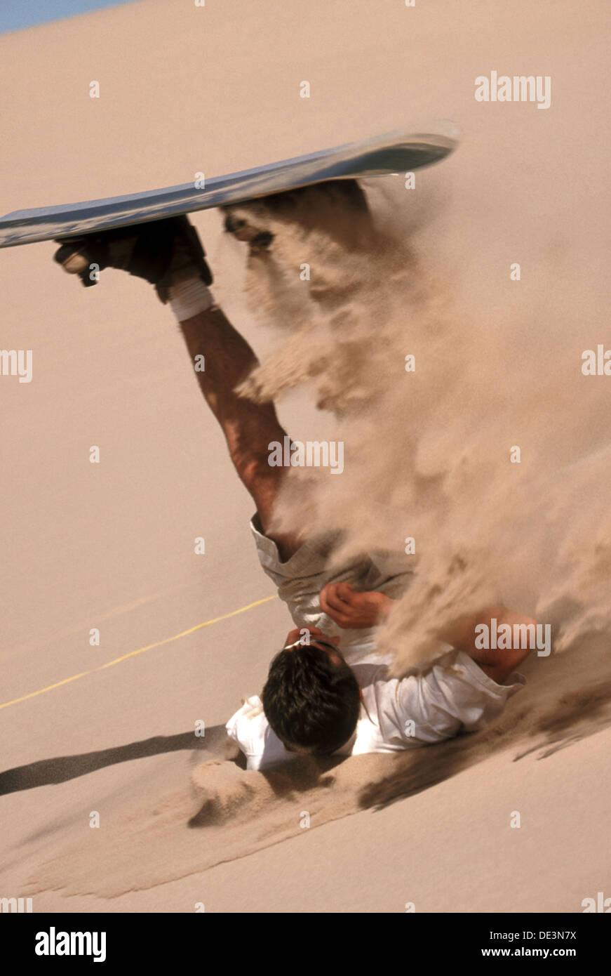 Backside slide spewing sand at Dumont Dunes. California. USA. - Stock Image