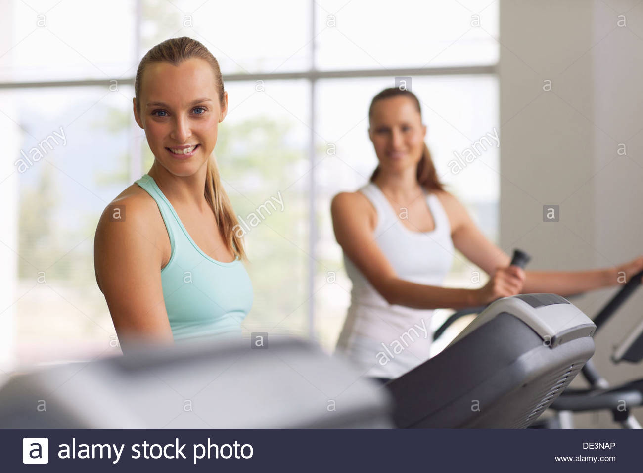 Two women working out in gym Stock Photo