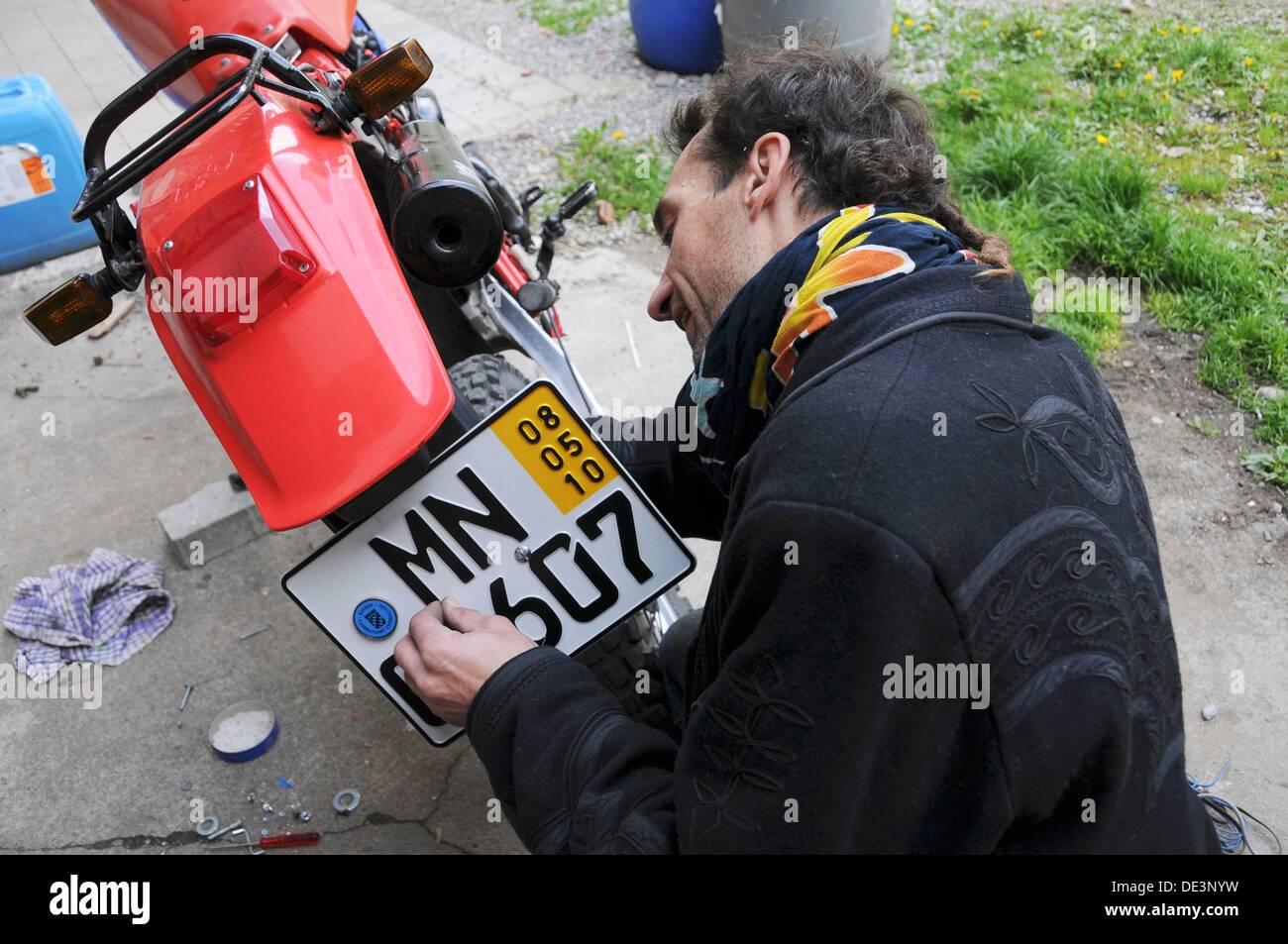 Man season indicator mounted on motorcycle - Stock Image