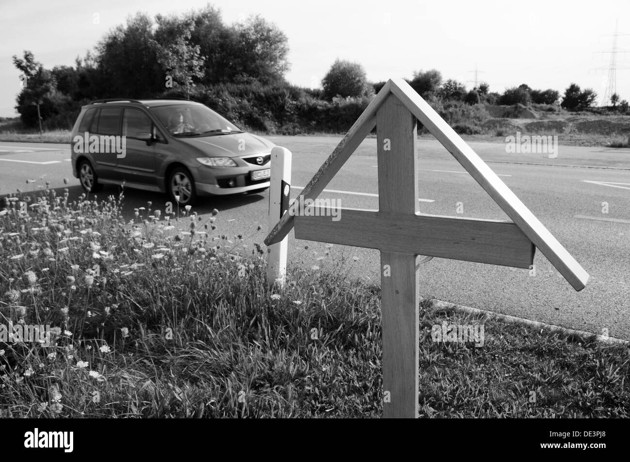 Cautionary cross at the accident site Stock Photo