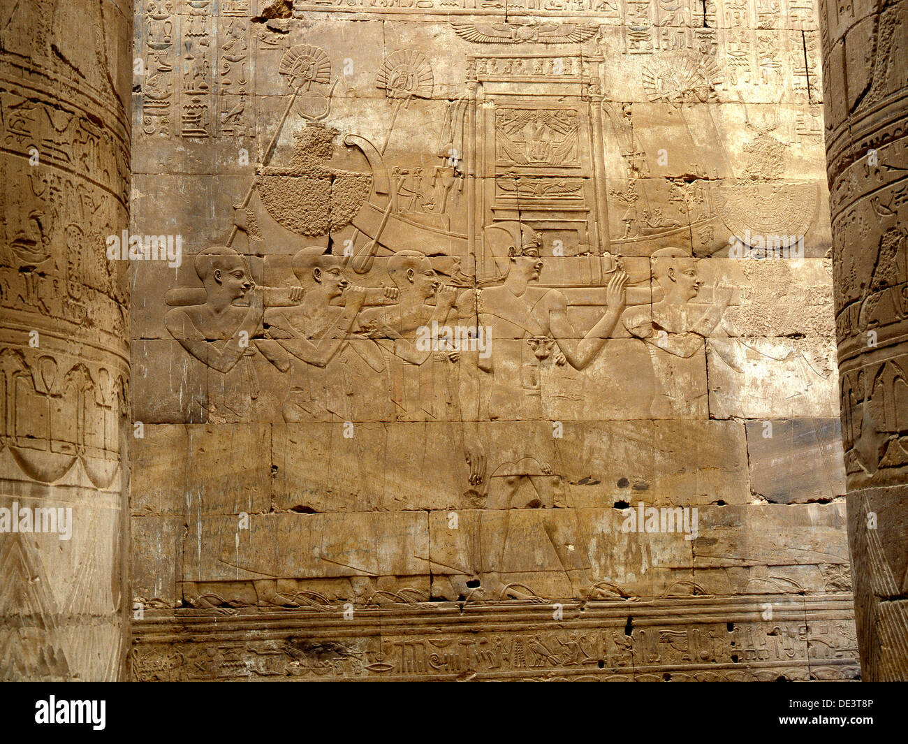 A relief in the Hypostyle Hall at Edfu depicting the procession of the sacred barque. - Stock Image