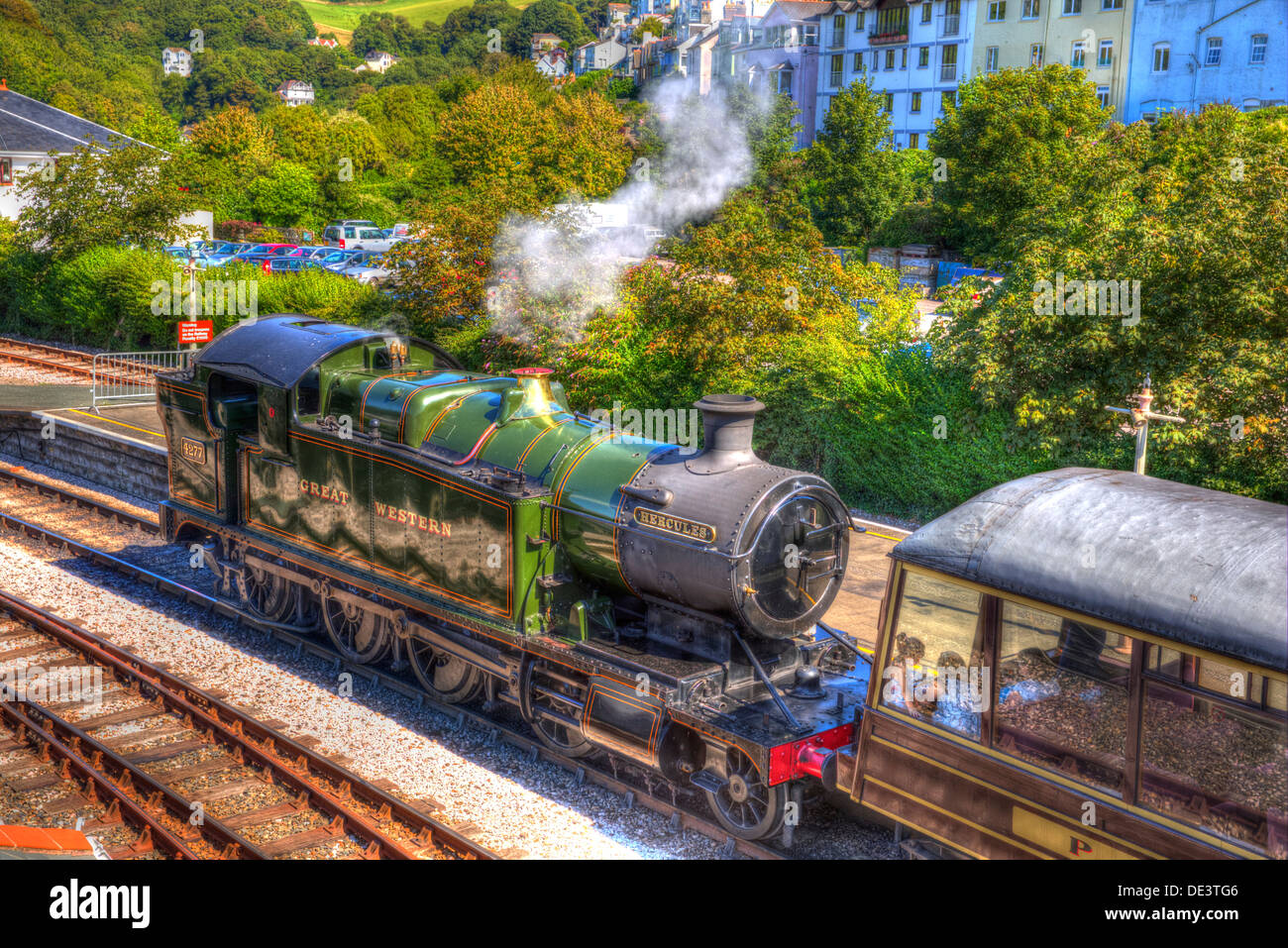 Steam Train letting off steam in the railway station like painting in HDR - Stock Image