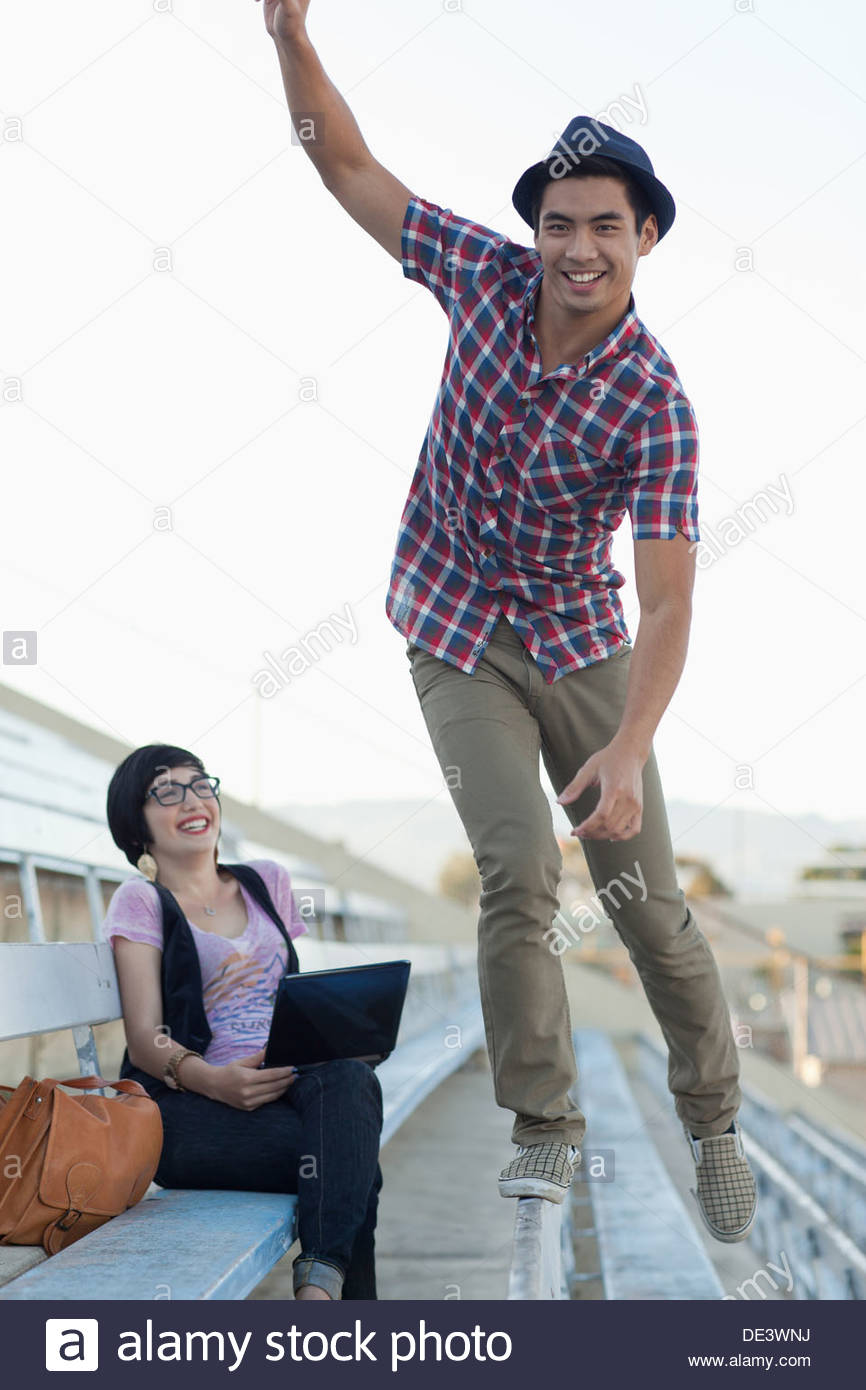 Students relaxing on bleachers - Stock Image