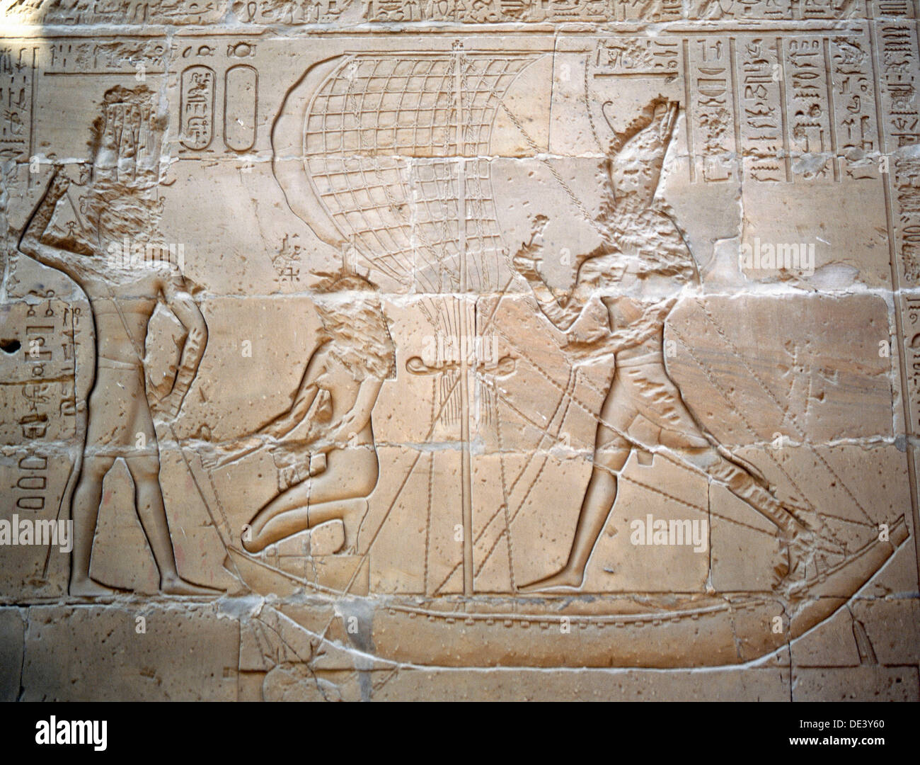 A relief at Edfu depicting the pharaoh in his sacred barque. - Stock Image