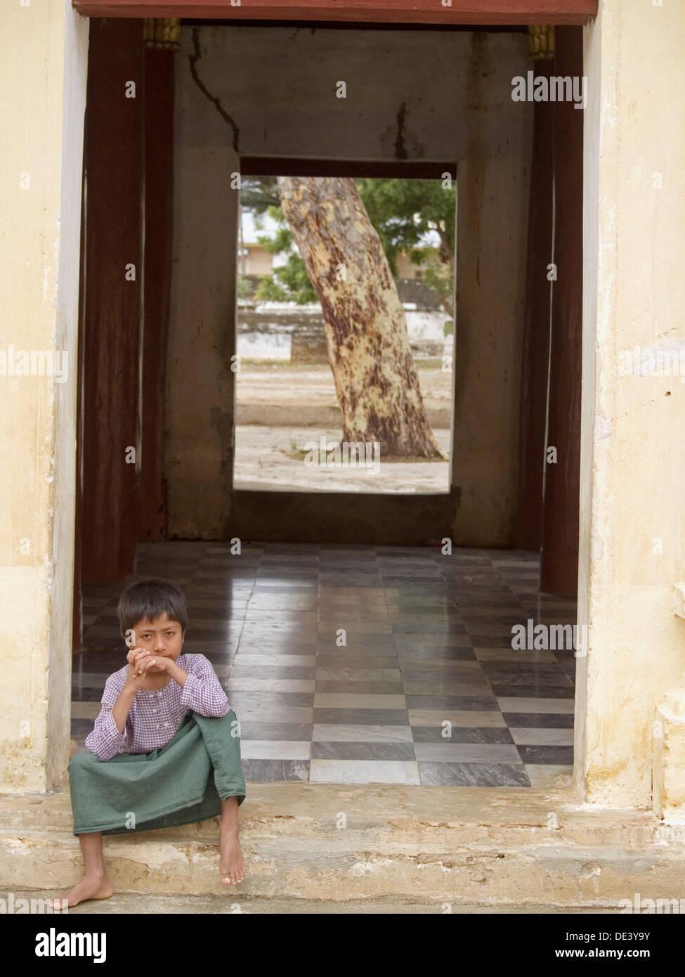 Boy in a doorframe in Bagan, Myanmar - Stock Image