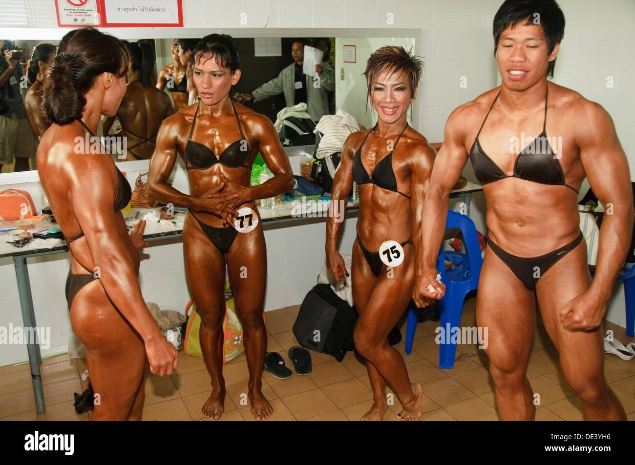 ladyboy bodybuilders taking part in a competition in