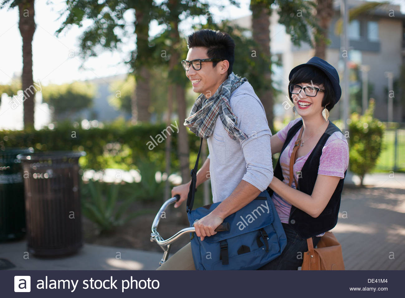 Two students on bicycle - Stock Image