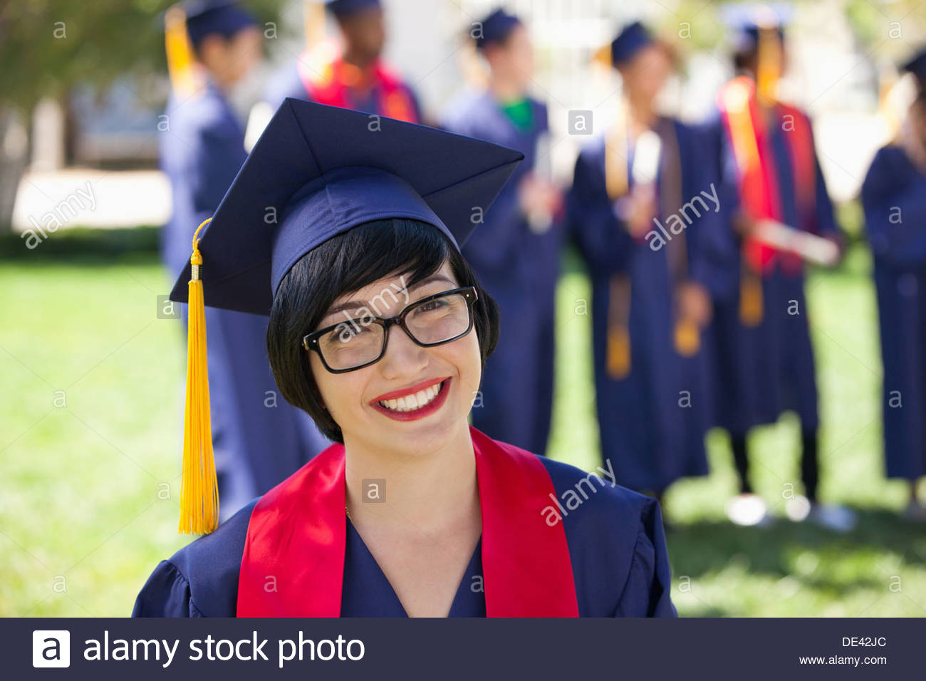 Graduate in cap and gown - Stock Image
