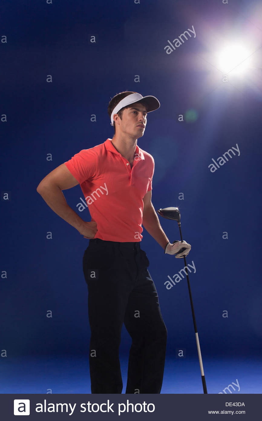 Golf player holding club - Stock Image