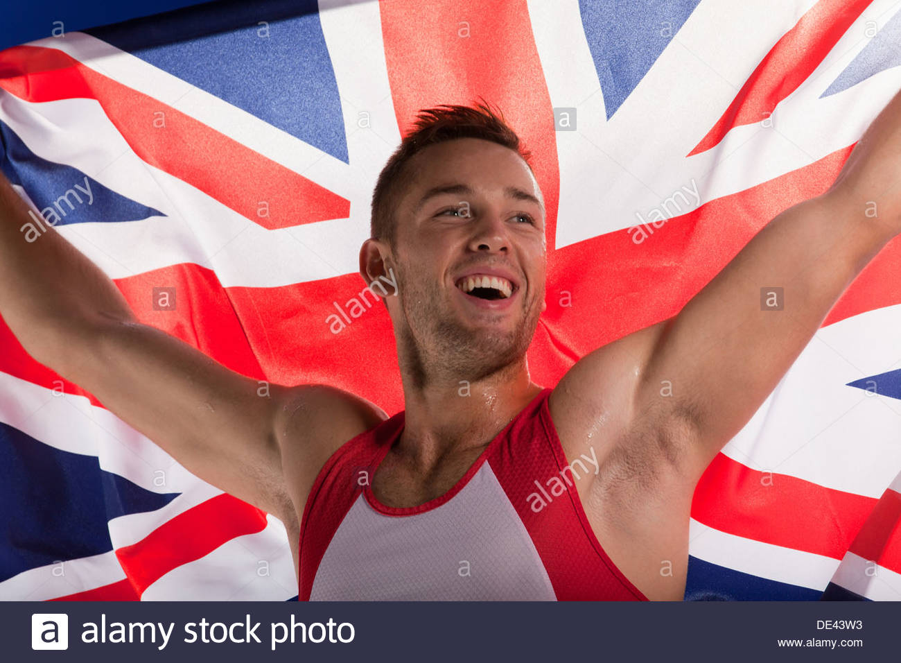 Athlete carrying Union Jack flag - Stock Image