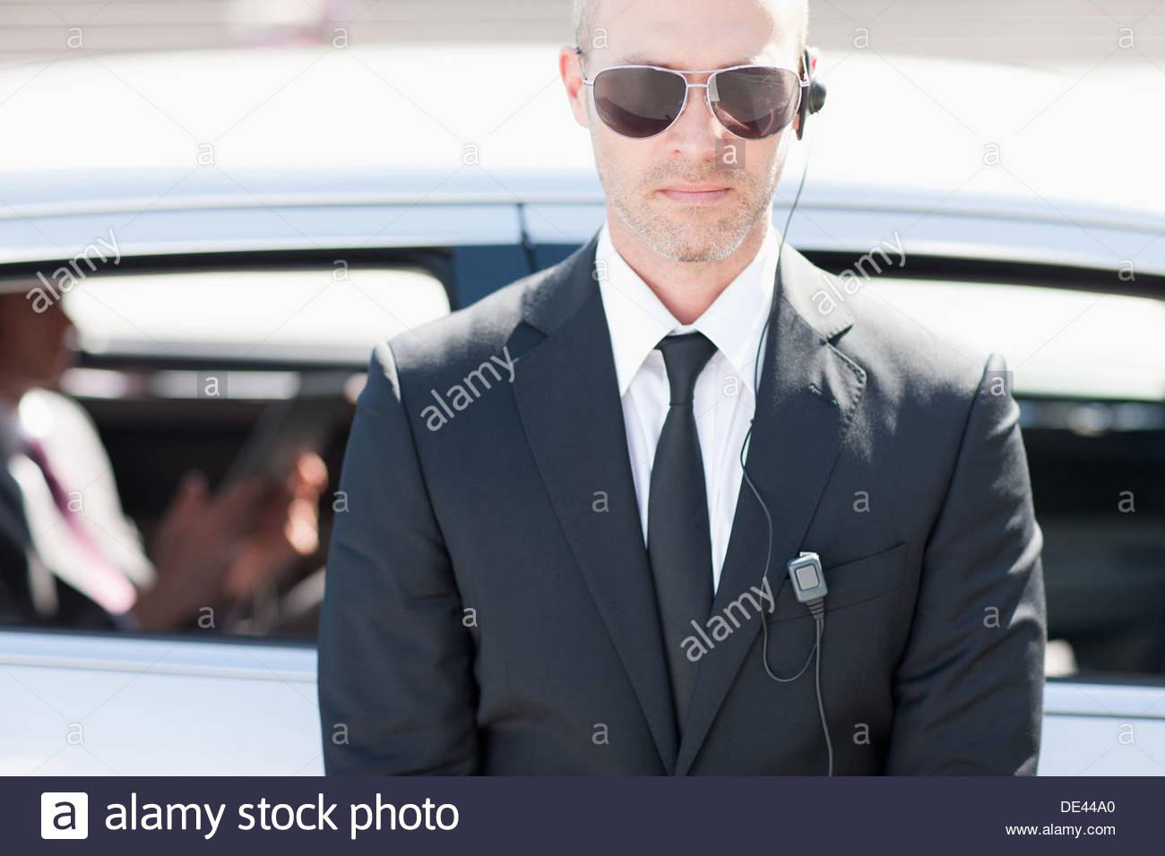 Bodyguard wearing earpiece - Stock Image