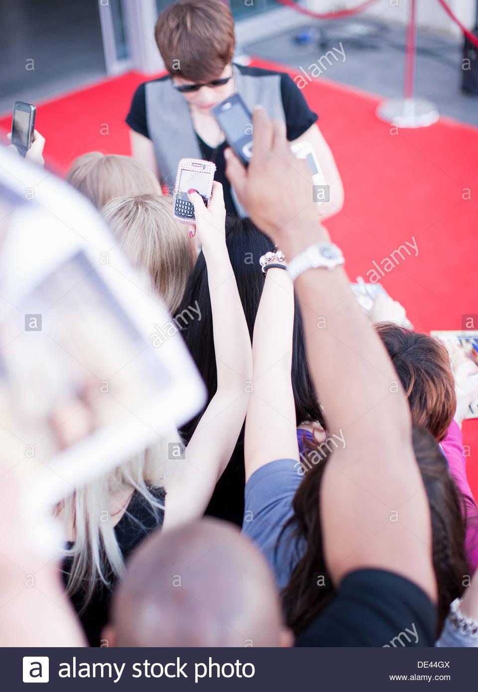 Celebrity signing autographs - Stock Image