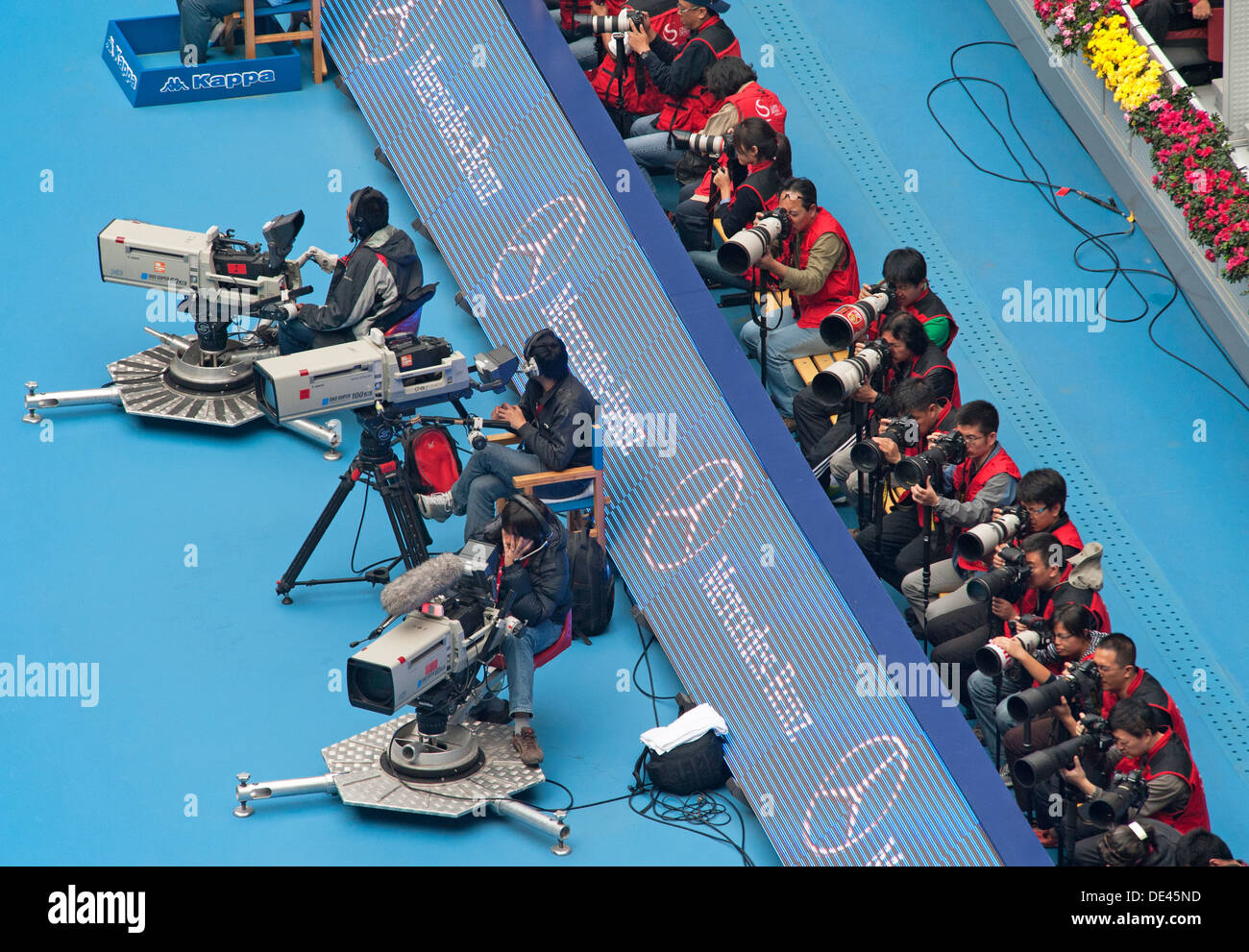Photographers and cameramen at a match between A. Ivanovic and A. Radwańska at the China Tennis Open on 7/10/2012 - Stock Image