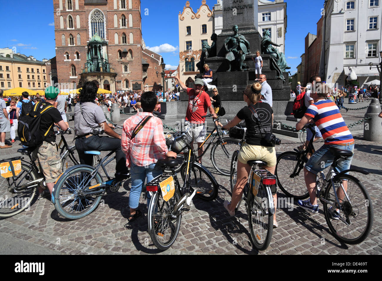 Guided sightseeing biker-Group at Rynek, Krakow, Poland - Stock Image