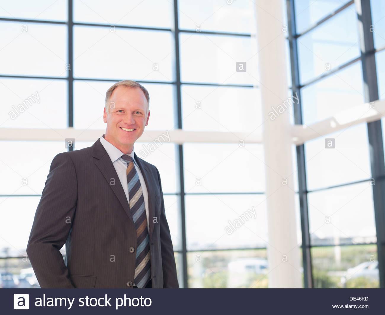 Businessman smiling - Stock Image