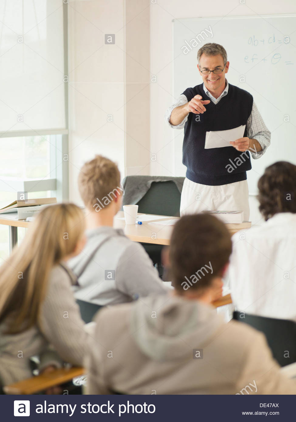 Professor at front of classroom - Stock Image