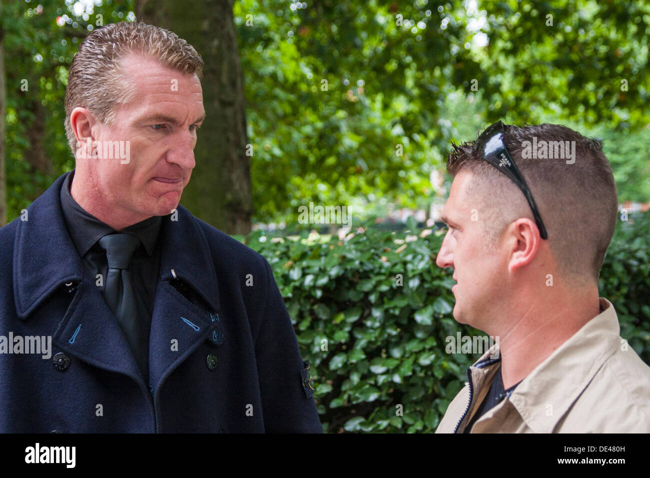 Grosvenor Square, London, UK. 11th Sep, 2013. EDL leader Stephen 'Tommy Robinson' Yaxley Lennon, right, and Kevin Carroll chat after laying flowers at the 9/11 memorial in Grosvenor Square, London on the anniversary of the terrorist attacks on America. Credit:  Paul Davey/Alamy Live News - Stock Image
