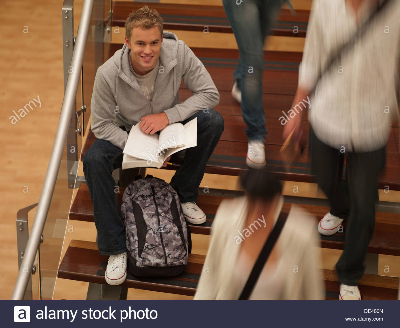 College students sitting on staircase - Stock Image