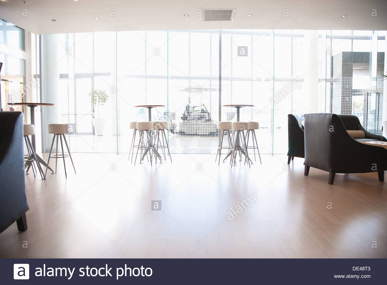 Tables and chairs in cafeteria - Stock Image