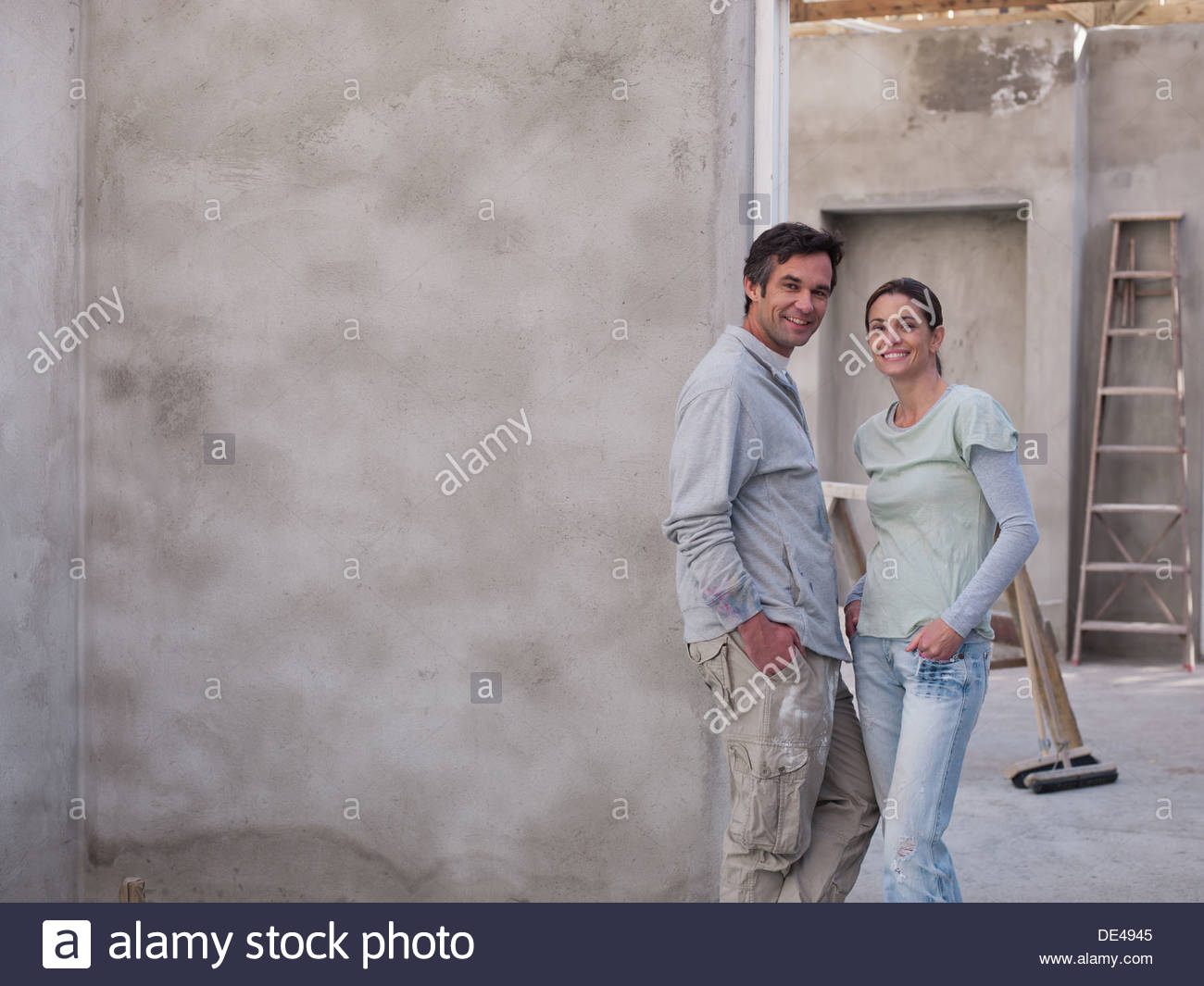 Couple in house under construction - Stock Image