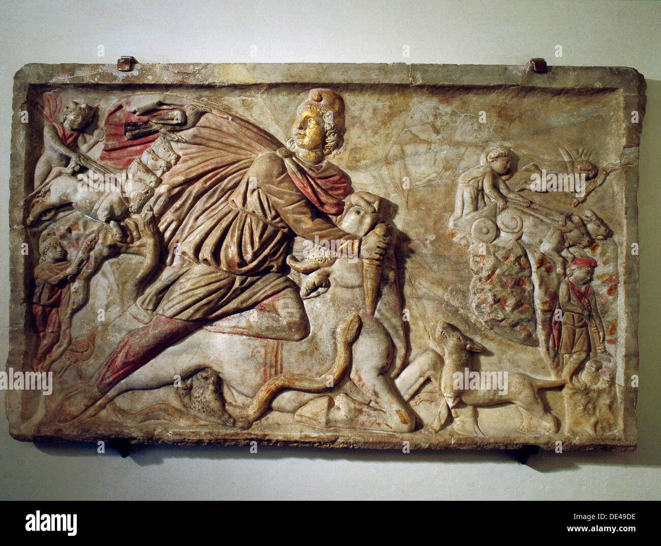 A relief of Mithras slaying the bull, the first of living creatures from whose blood, corn and all other forms of life arose. - Stock Image
