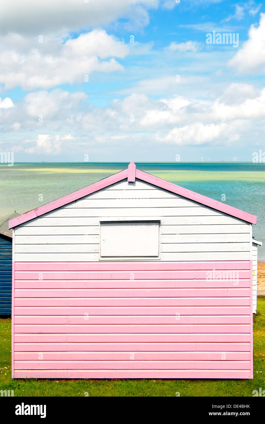 Whitstable, Kent, England, UK, Britain, Europe. Colourful beach huts overlooking the Thames estuary on the north Kent coast - Stock Image