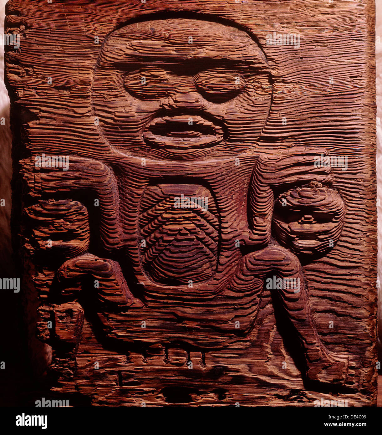 A cedar box carved in relief with a shaman displaying human heads
