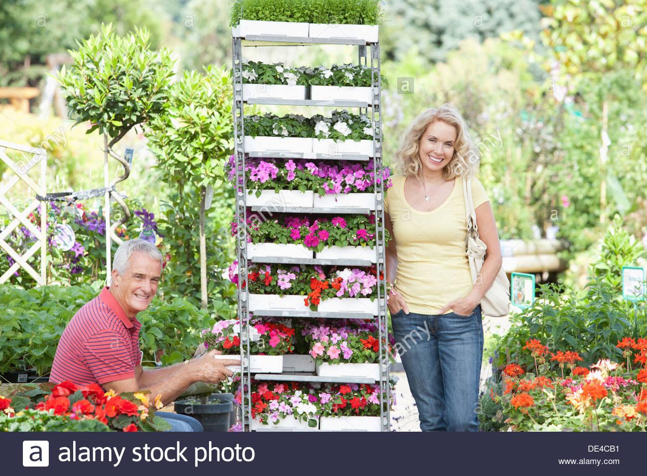 Couple buying flowers in nursery - Stock Image