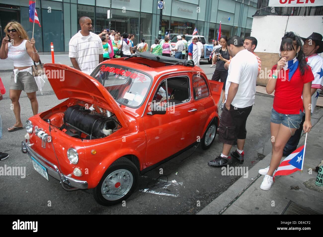 New York City (USA): an Italian car FIAT Cinquecento at the Puerto Rican parade - Stock Image
