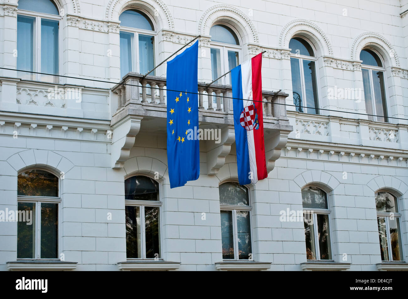 Croatian and European Union flags on a government building, Zagreb, Croatia - Stock Image
