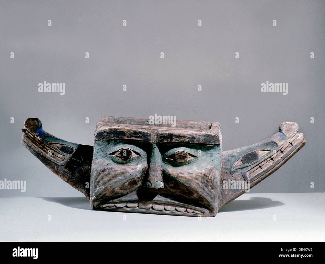 Feast bowl carved and painted with the mythological serpent Sisiutl. - Stock Image