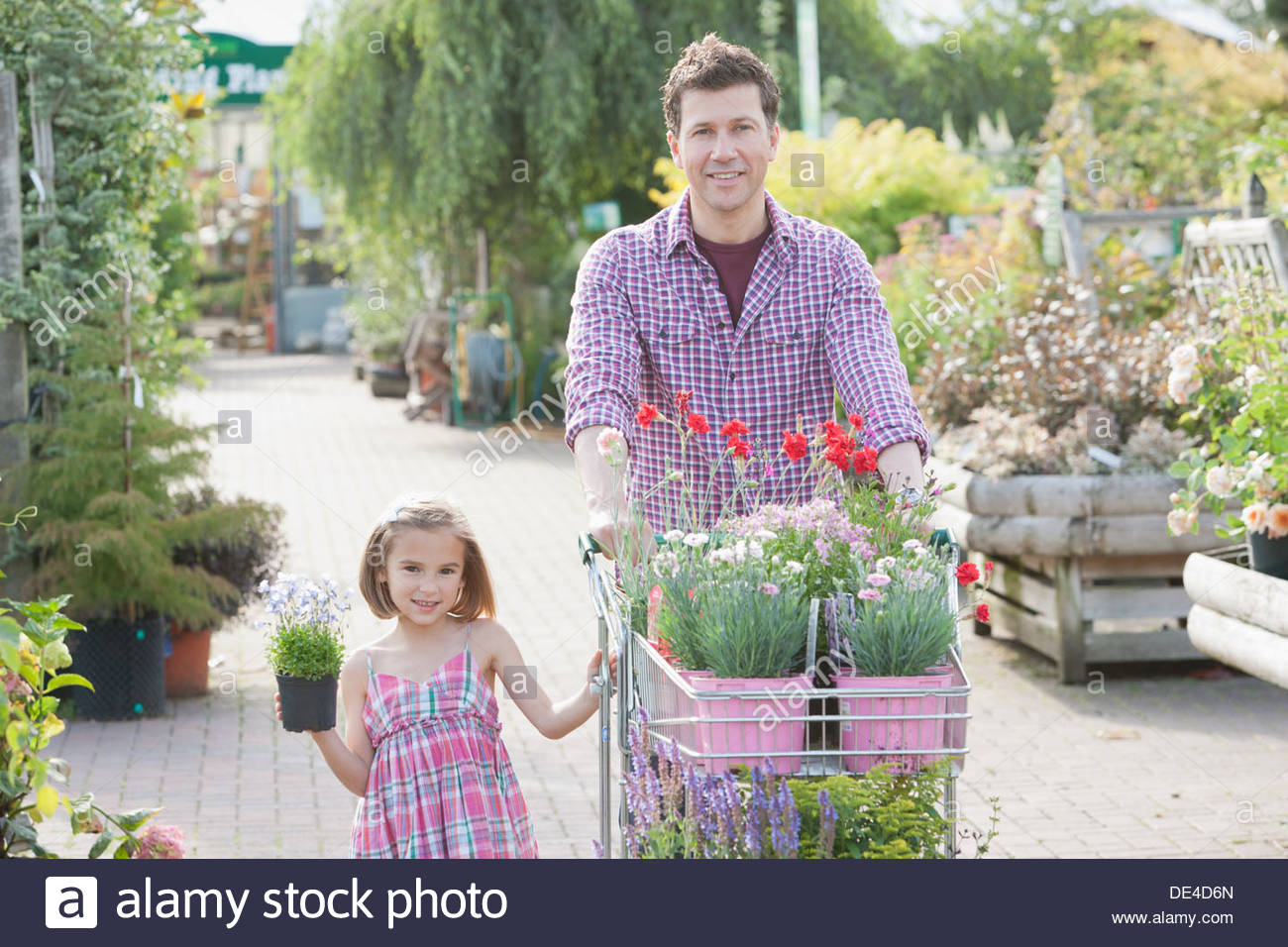 Father and daughter shopping together in nursery - Stock Image