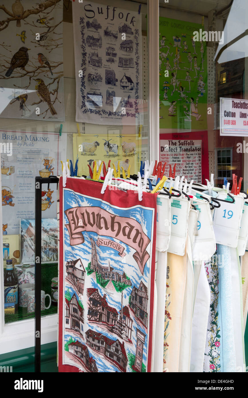 An exterior shop display of souvenir tea-towels of Suffolk, and the Suffolk town of Lavenham, England. - Stock Image