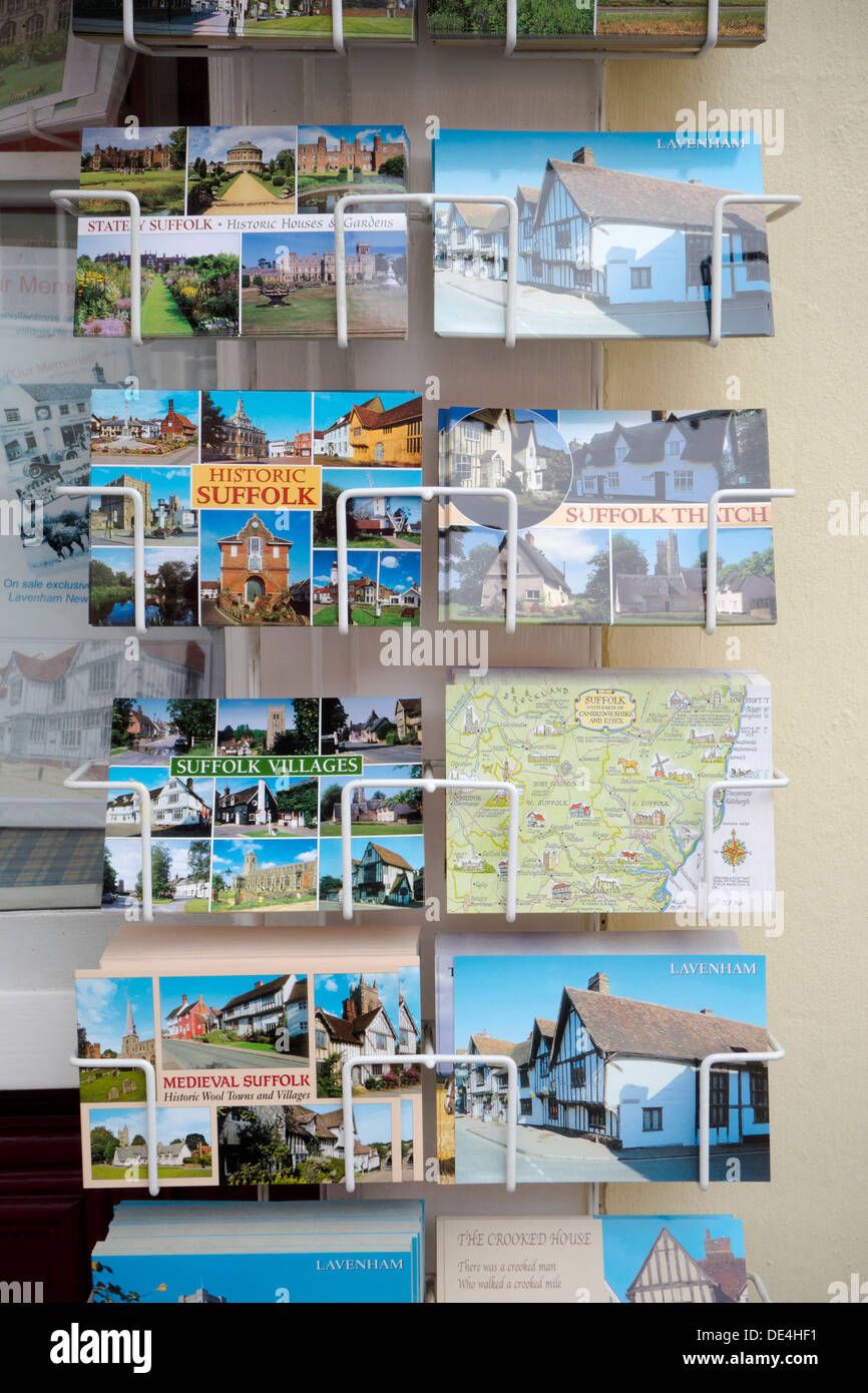 An exterior wall display of colourful postcards of Lavenham in Suffolk. - Stock Image