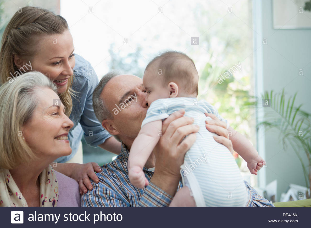 Grandparents and mother with baby boy - Stock Image