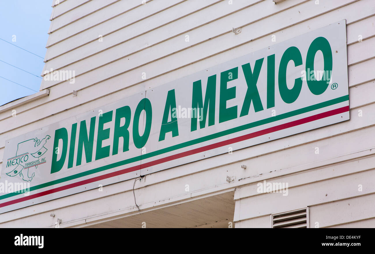 WOODBURN, OREGON, USA - Dinero a Mexico sign on storefront that offer remittance service to Mexican immigrant community. - Stock Image