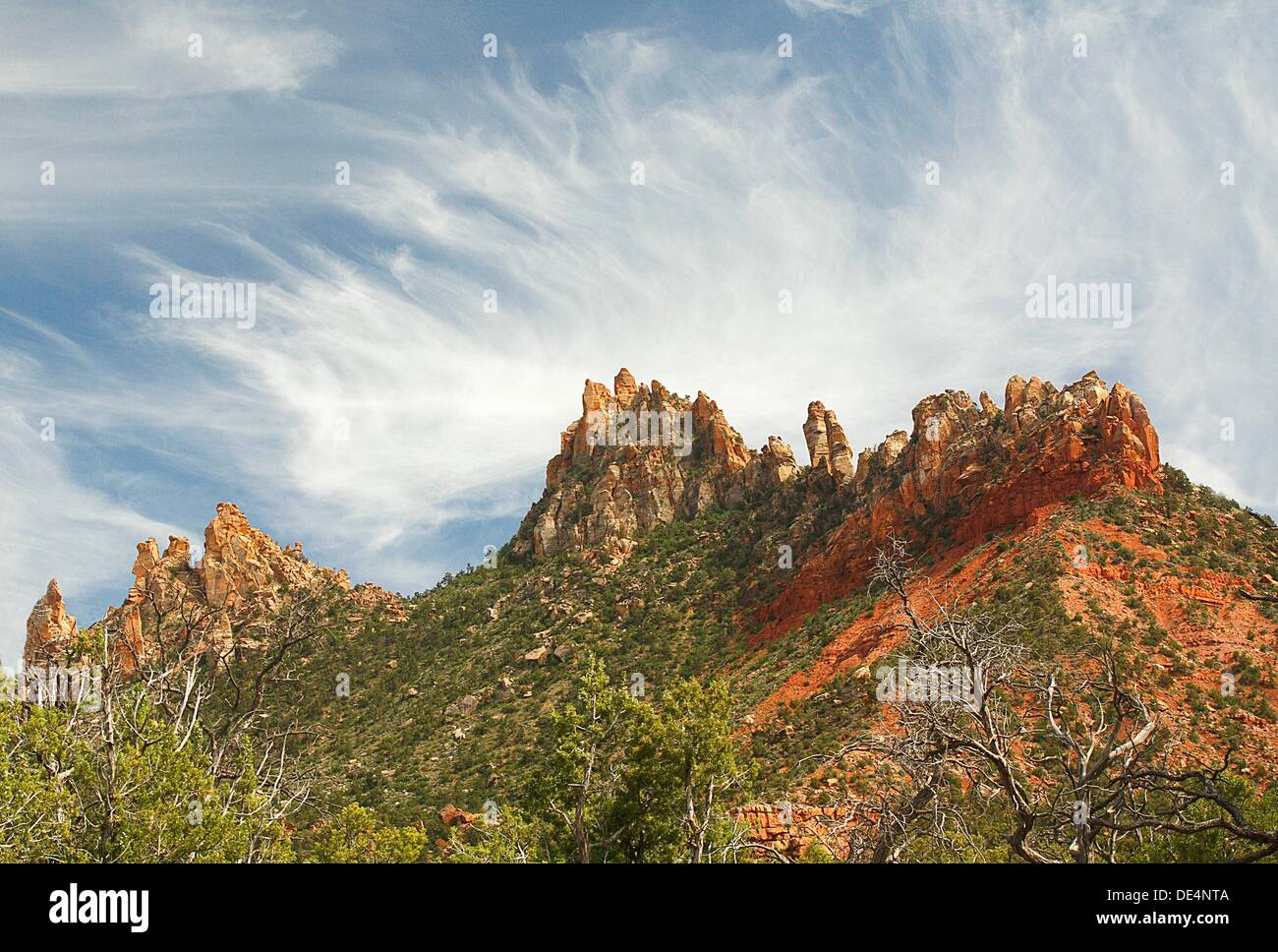 Wispy clouds encircle the Eagle Crags near Zion National Park, Utah - Stock Image