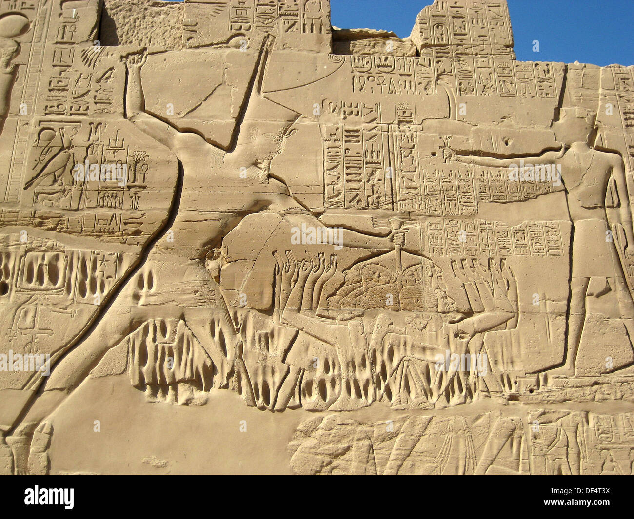 Tuthmosis III smiting his enemies, the Cannaanites, at the Battle fo Megiddo from the north wall of the Great Hypostyle Court. - Stock Image