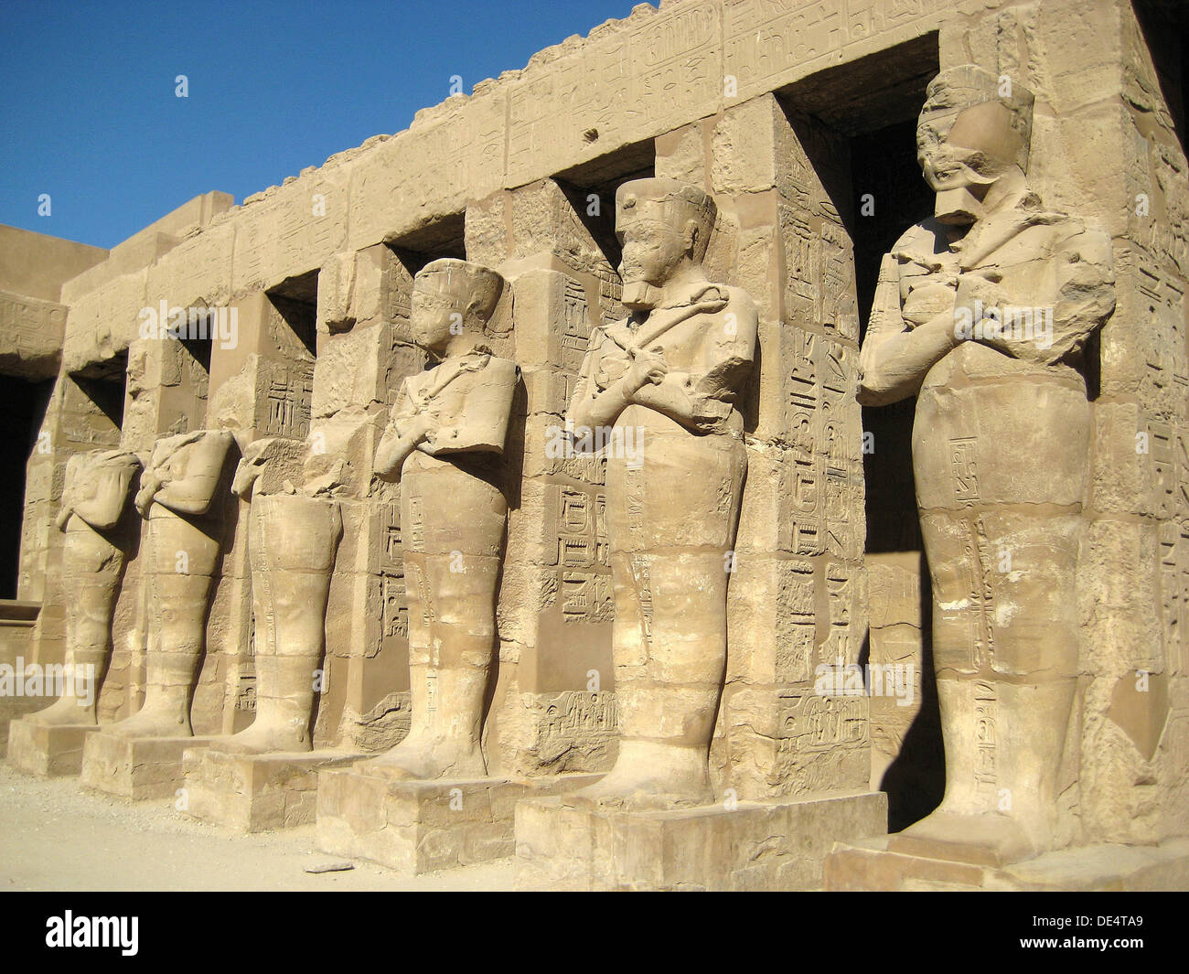 Temple of Ramses III, showing the mummy-shaped sculptures of the pharaoh. - Stock Image
