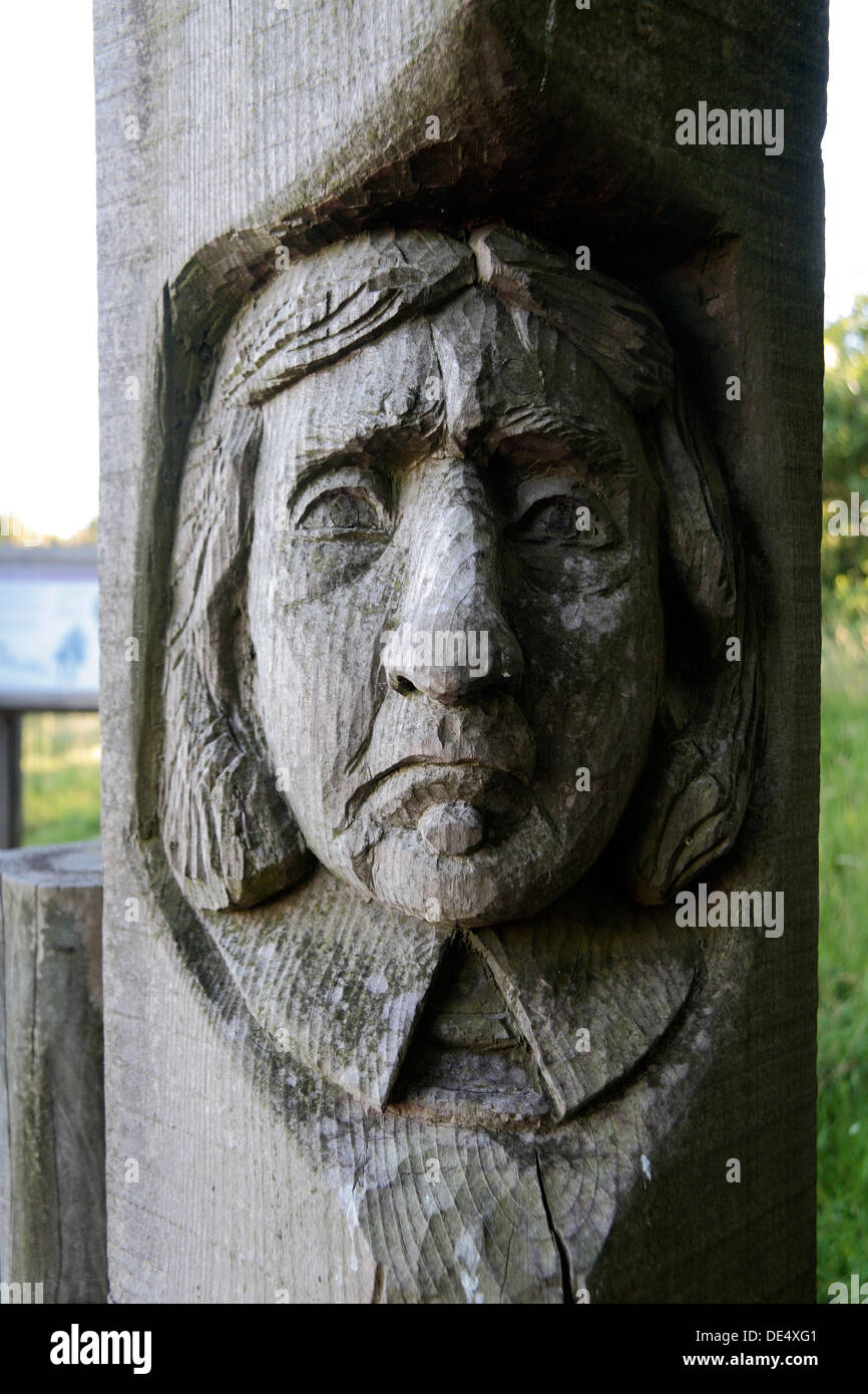 Face engraved on an entrance gate post to The Rings, a Scheduled Ancient Monument, Corfe Castle, Dorset, UK. - Stock Image