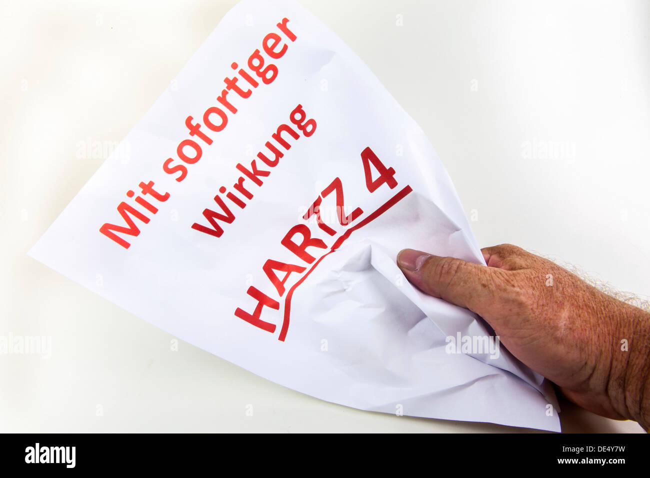Crumpled letter, Mit sofortiger Wirkung Hartz 4, German for with immediate effect, Hartz 4, German welfare benefits - Stock Image