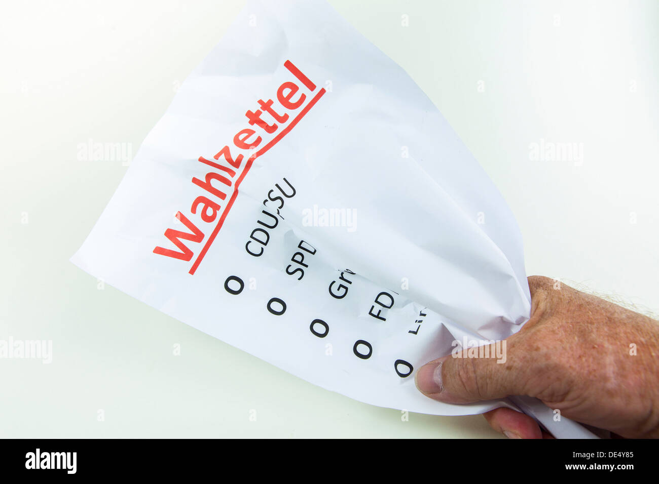Crumpled ballot paper, symbolic image for non-voters or election frustration - Stock Image
