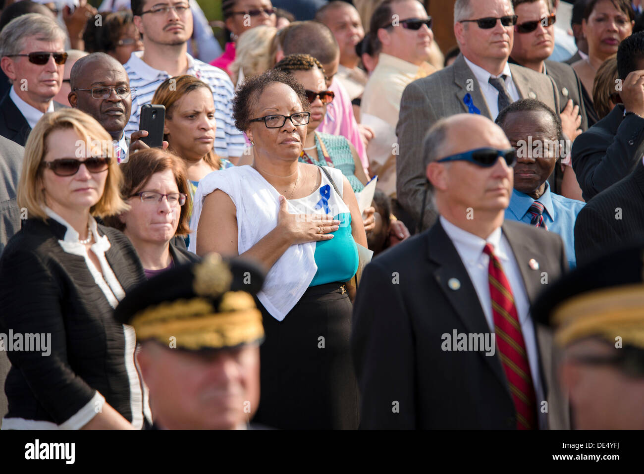 Arlington, Virginia, USA. 11th Sep, 2013. Family members of those killed during the 9/11 terrorist attack on the Pentagon stand in memory of those who lost their lives during the Pentagon Observance Ceremony September 11, 2013 in Arlington, VA. Credit:  Planetpix/Alamy Live News - Stock Image