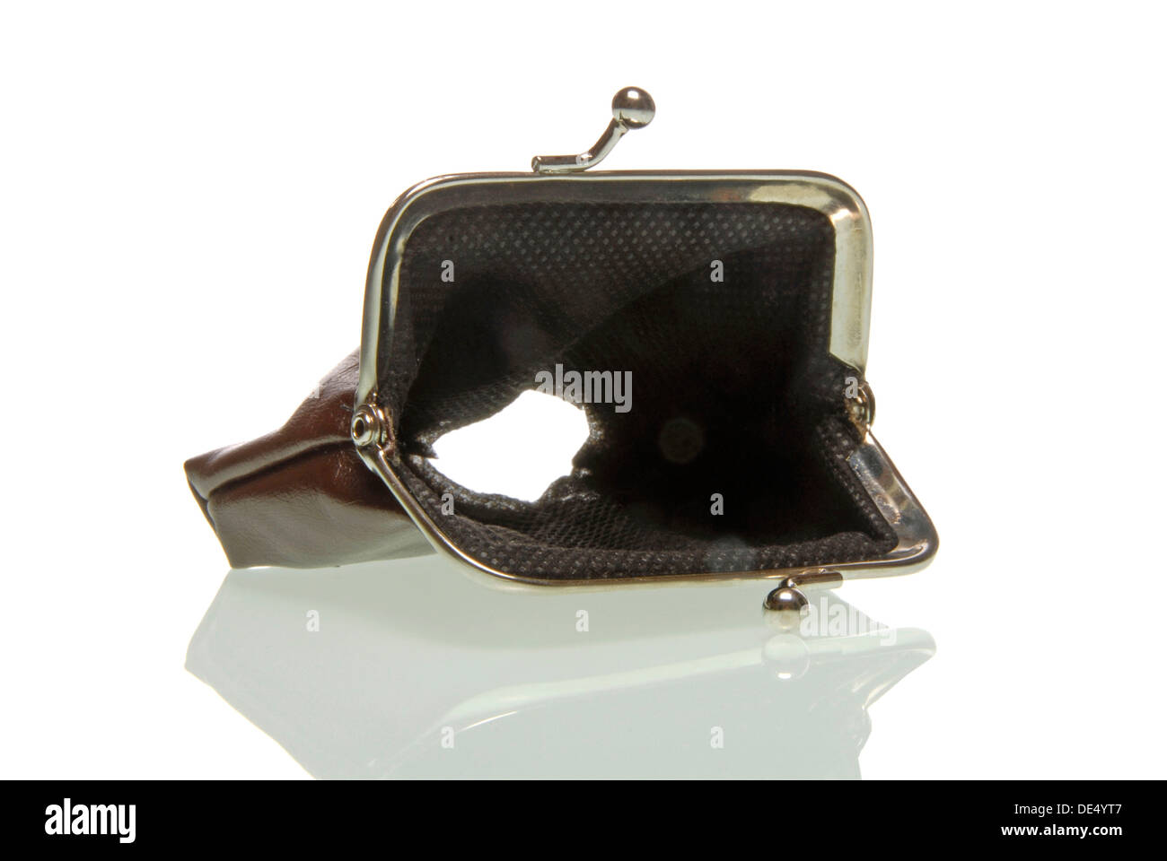 Purse with a hole, symbolic image for the economic crisis - Stock Image