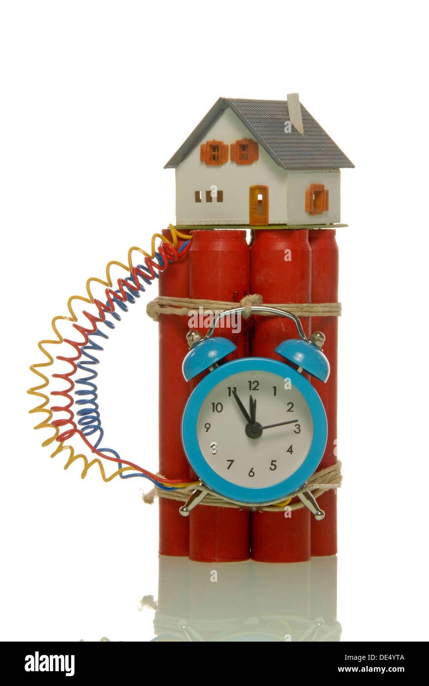 Miniature house on a bomb, symbolic image of a hazardous housing market - Stock Image