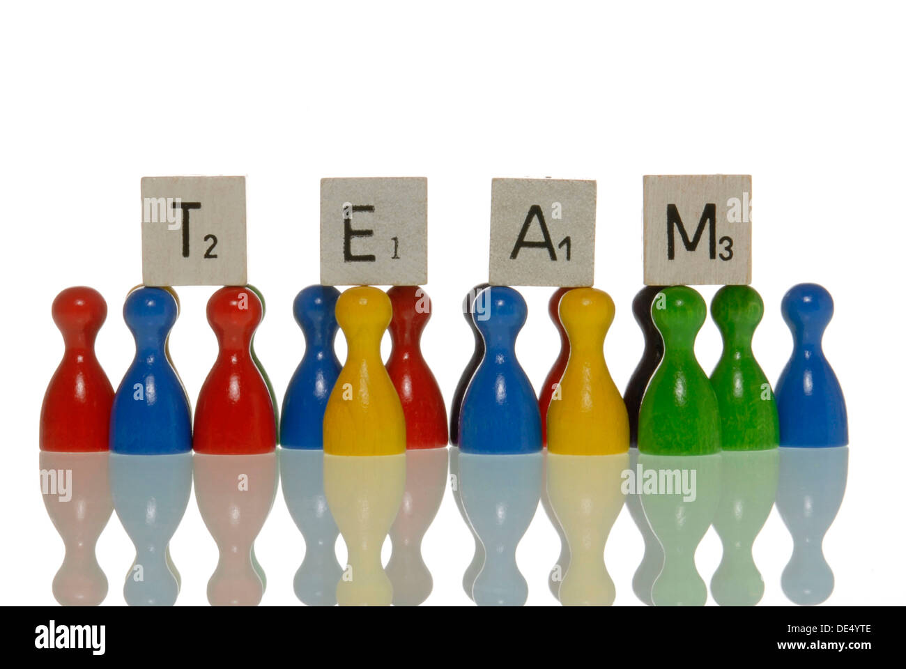 Game figures and letter tiles, spelling the word team - Stock Image