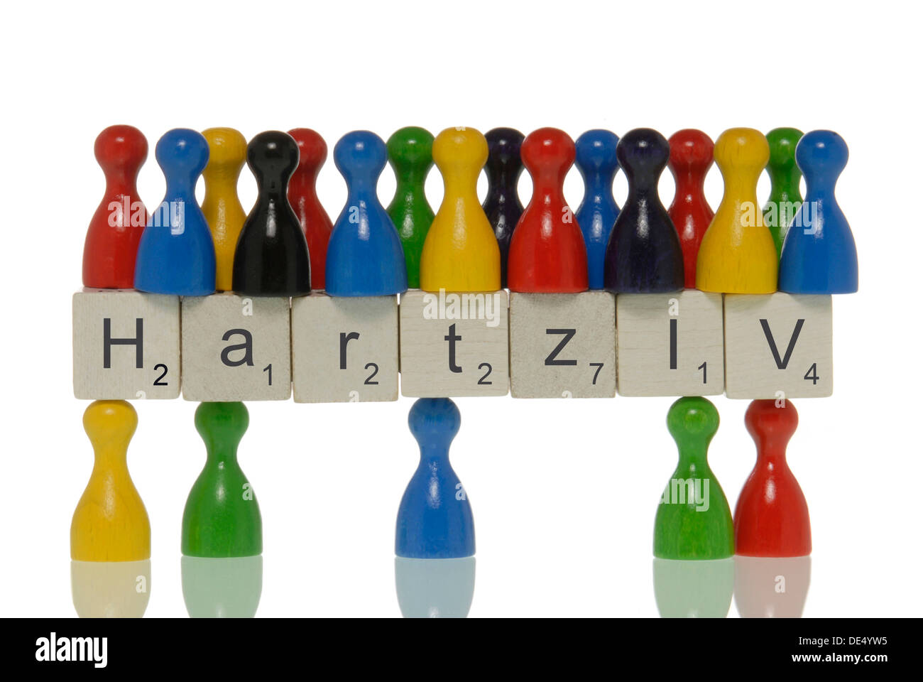Few game pieces carrying more game pieces on scrabble pieces with the lettering 'Hartz IV', symbolic for demographic, Hartz IV - Stock Image